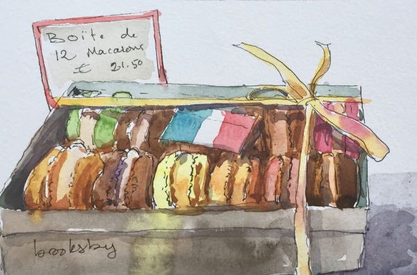 Ink and watercolor illustrations of French macarons in paris